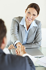 Hiring - Smiling business woman shaking hands with person